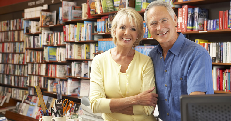 business owners, woman and man in book store