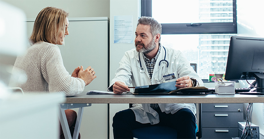 doctor and patient discussing treatment plans.