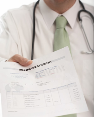 doctor handing billing statement to someone