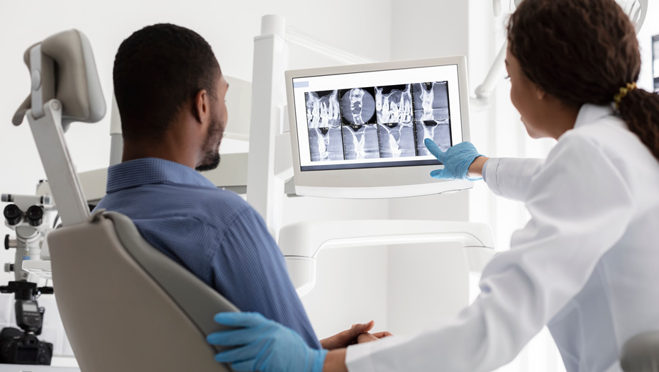 dentist discussing x-rays with patient
