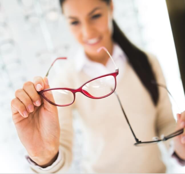 A woman looking at glasses
